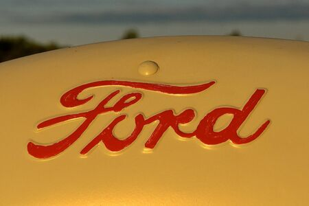 SABEL, SOUTH DAKOTA, June 22, 2017: The rusty Ford tractor hood logo is a product of the Ford Motor Company located in Dearborn, Michigan started by Henry Ford and incorporated on June 16, 1903