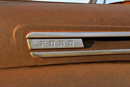 ISABEL, SOUTH DAKOTA, June 22, 2017: The rusty Ford pickup hood logo is a product of the Ford Motor Company located in Dearborn, Michigan started by Henry Ford and incorporated on June 16, 1903.