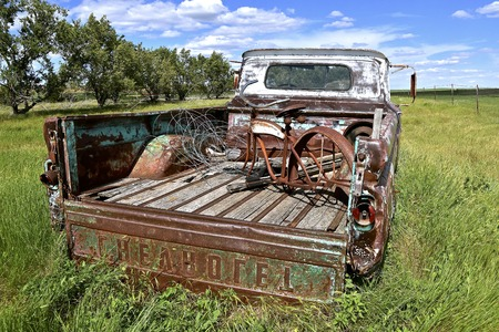 FIRESTEEL, SOUTH DAKOTA, June 22, 2017: The old rusty 40`s pickup colloquially referred to as Chevy and formally the Chevrolet Division of General Motors Company, is an American automobile division of the American manufacturer