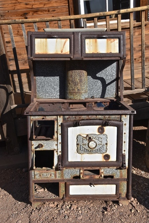 MESA, ARIZONA, February 6, 2018: The very old Home Comfort stove is a product of  the Wrought Iron Company founded in St. Louis, MO. in 1881