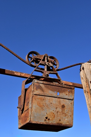 A bucket used to transport copper on an aerial cable from a mining pit