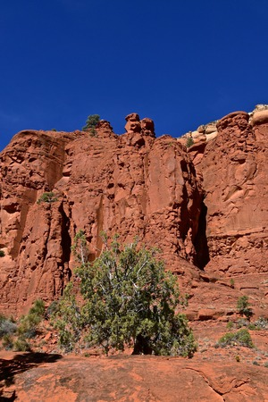 Red rock mountain range of Sedona, Arziona against a clear blue sky.