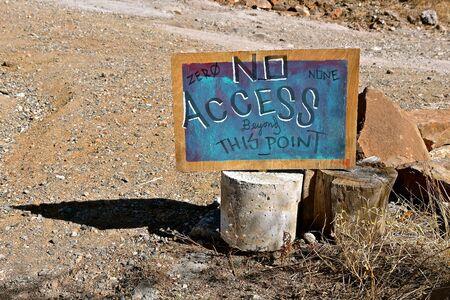 Homemade chalk board sign established boundaries in a rural gravel setting Stock Photo