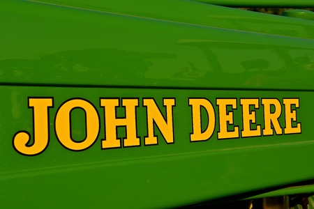 YANKTON, SOUTH DAKOTA, August 19, 2017: The new JOHN DEERE words identify machinery for the John Deere Co, an American corporation that manufactures agricultural, construction, forestry machinery, diesel engines, and drivetrains.