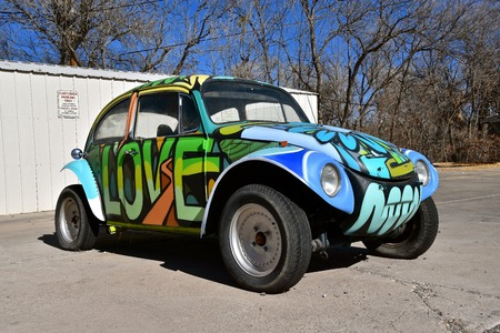 JEROME, ARIZONA,  January, 30, 2018:  The 1960`s old  Love Bug car is a product of Volkswagen Group, one of the world`s largest car industries in the world founded in Berlin in 1937.