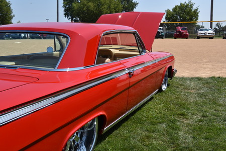 YANKTON, SOUTH DAKOTA, August 19, 2017: The restored classic red 1962 Chevy Impala  is displayed at the car show at Riverboat Days in Yankton, SD, held annually each 3rd weekend of August. Editorial