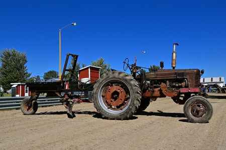 DALTON, MINNESOTA, Sept 8, 2017: An old M Farmall,pulling a road leveler is used and displayed at the annual September Dalton, MN tractor show where 1000s attend.