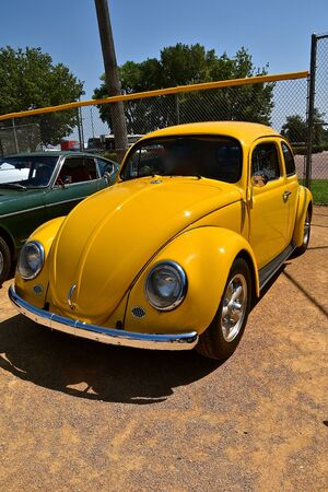 YANKTON, SOUTH DAKOTA, August 19, 2017: The restored classic gold 1963 Volkswagon is displayed at the car show at Riverboat Days in Yankton, SD, held annually each 3rd weekend of August.