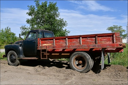 HAWLEY, MINNESOTA, August 22, 2017: The old truck with a box for carrying loads is from the 40`s or 50`s, is a Chevrolet, colloquially referred to as Chevy and formally the Chevrolet Division of General Motors Company, is an American automobile division o