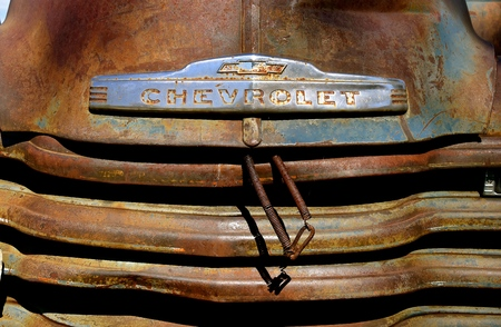 HAWLEY, MINNESOTA, August 22, 2017: The old pickup with a logo from the 40`s or 50`s, is a Chevrolet , colloquially referred to as Chevy and formally the Chevrolet Division of General Motors Company, is an American automobile division of the American manu