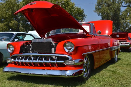 YANKTON, SOUTH DAKOTA, August 19, 2017: The restored classic red 1954 Chevy Belair  Convertible isdisplayed at the car show at Riverboat Days in Yankton, SD, held annually each 3rd weekend of August.