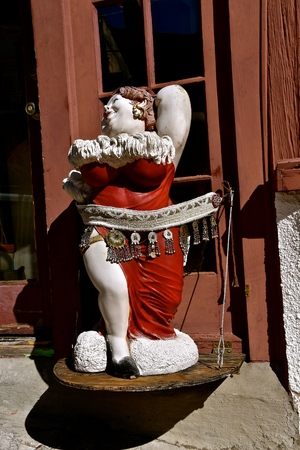 JEROME, ARIZONA, January 30, 2018: The statue of a lady is in front of the The Bordello of Jerome, AZ which opened in 2015, and is a quaint, quirky restaurant in the old mining town. Editorial