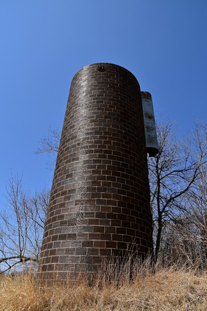 An old brick silo with part of the chute still attached is all which remains from a past dairy farm.