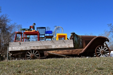 A home made vehicle representing a cross between a trailer and a truck is loaded with old furniture. Banque d'images