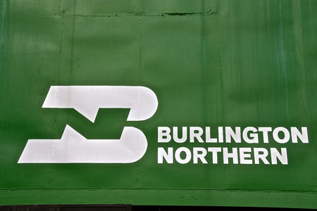 NISSWA, MINNESOTA, April 24, 2018: The BN logo on the side of the green caboose was once property of Burlington Northern which has since become BNSF, part of Berkshire Hathaway subsidiary. Editorial