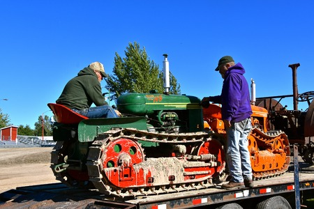 DALTON, MINNESOTA, Sept 8, 2017: Several restored  Cletrac (tractor on tracks) loaded on a flat bed trailer will be  displayed at the annual September Dalton, MN tractor  and farm show where 1000s attend the second full weekend. 에디토리얼