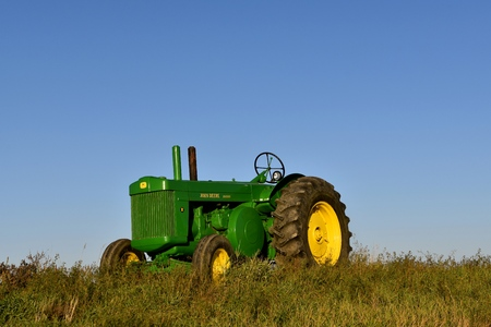 HENDRUM, MINNESOTA, October 6, 2017: The old restored John Deer R tractor is a product of John Deere Co, an American corporation that manufactures agricultural, construction, forestry machinery, diesel engines, and drivetrains