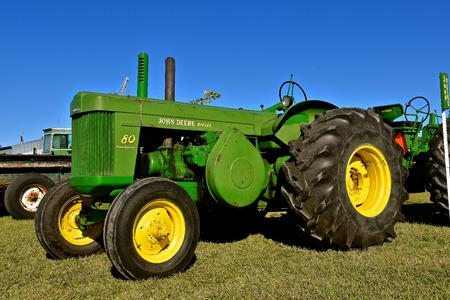 DALTON, MINNESOTA, Sept 8, 2017: A partially restored huge Diesel 80 two cylinder John Deere tractor is displayed at the annual September Dalton, MN tractor  and farm show where 1000s attend the second full weekend.