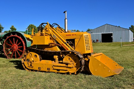 DALTON, MINNESOTA, Sept 8, 2017: A restored Oliver OC -3 bulldozer tractor with a bucket is displayed at the annual September Dalton, MN Threshing and Farm show where 1000s attend the second full weekend. Editorial