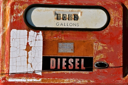 Closeup of an old faded diesel fuel pump displaying a sale of 105 gallons.