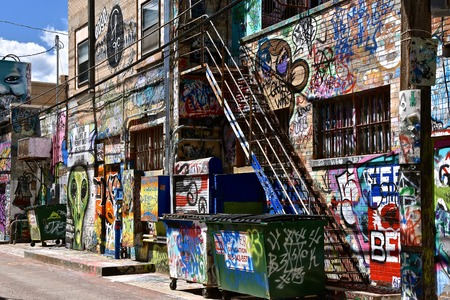 RAPID CITY, SOUTH DAKOTA, May 23, 2018: The paint graffiti art is found in Art Alley, Sioux Falls, began as a public art project in 2005 and has become a living tribute to freedom of expression between 6th and 7th street. Editorial