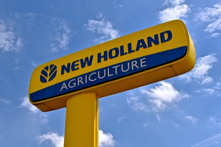 RAPID CITY, SOUTH DAKOTA, May 22, 2018: The New Holland sign advertises the products of global brand of agricultural machinery produced by CNH Industrial manufacturing tractors, combines, balers, sprayers and haying tools,