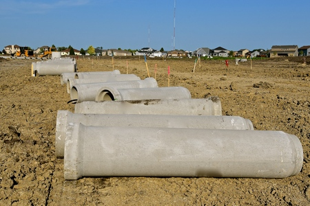 A new housing development is in the process as storm sewer pipe waits for the trenches to be excavated.