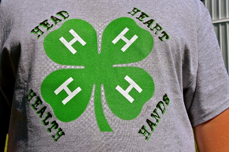 BARNSEVILLE, MINNESOTA, July 12, 2018: The T-shirt displays a 4-H club member, which is a global network of youth organizations whose mission is `engaging youth to reach their fullest potential while advancing the field of youth development.