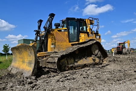 MOORHEAD, MINNESOTA, July 21, 2018: Founded in 1925, the D6T Cat bulldozer  full of mud is from Caterpillar Inc., an American corporation which designs, develops, engineers, manufactures, markets and sells machinery, engines, financial products and insurance.