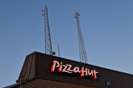 BISMARCK, NORTH DAKOTA, August 4, 2018: The Pizza Hut signage represents an American restaurant chain and iinternatinal franchise founded in 1958 by Dan and Frank Carney and a subsidiary of Yumi Brands, Inc.