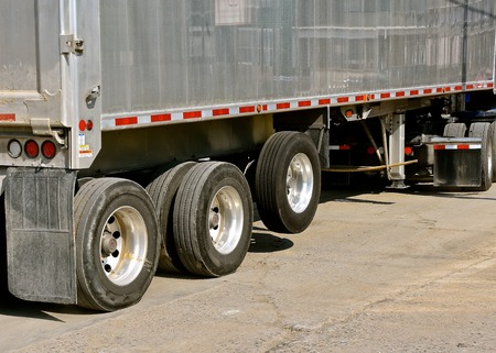 A semi trailer with a third set rear wheel and axle for heavy loads