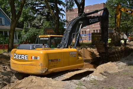FARGO, NORTH DAKOTA, August 1, 2018: The huge  200D front end excavator is a product of John Deere Co, an American corporation that manufactures agricultural,