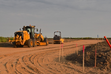 MOORHEAD, MINNESOTA, August 14, 2018: Founded in 1925, the Cat excavators used in road construction are from Caterpillar Inc., an American corporation which designs, develops, engineers, manufactures, markets and sells machinery, engines, financial produc