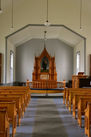 Interior of an old Lutheran country church with altar and cross in the front