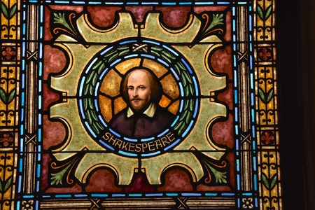 BONANZAVILLE, NORTH DAKOTA, August 17, 2018: The old stained glass window with William Shakespeare of an old town hall building is open for viewing during Pioneer Days