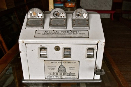 BONANZAVILLE, NORTH DAKOTA, August 17, 2018: An old antique stamp machine( the American Postmaster) is  displayed during Pioneer Days  at Bonanzaville annually in August.