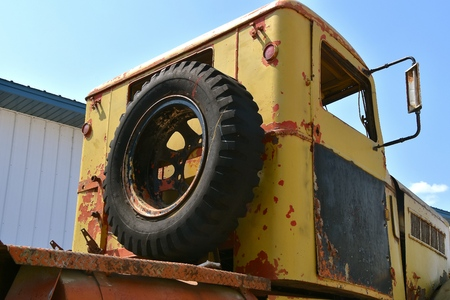 An old rusty cab of a flat bed truck