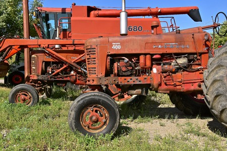 VALLEY CITY, NORTH DAKOTA, August 21, 2018:  The red tractor parked in a machinery lineup is a Farmall 400 which later became part of the International Harvestor(IH) corporation.