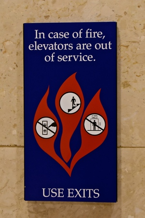 Information sign of proper evacuation and behavior when exiting a building in case of fire