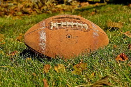 An old vintage football displaying much wear is a reflection of former gridiron days.