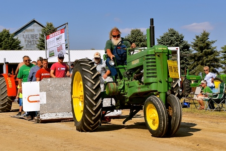 PEKIN, NORTH DAKOTA, September 2, 2018:  The old John Deere B tractor is participating in a tractor pull at the annual Labor Day Stump Lake Village Threshing Bee. Editöryel