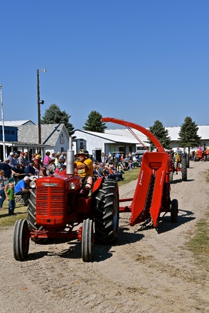 PEKIN, NORTH DAKOTA, September 2, 2018:  The old McCormick Deering   tractor and single row silage chopper are being displayed at the parade during the  Labor Day Stump Lake Village Threshing Bee.
