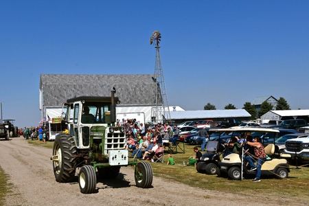 PEKIN, NORTH DAKOTA, September 2, 2018:  The old Oliver cab tractor is participating in a parade during the  Labor Day Stump Lake Village Threshing Bee.