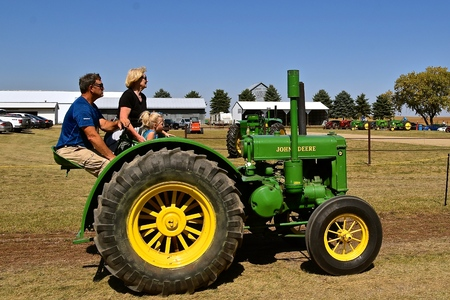 PEKIN, NORTH DAKOTA, September 2, 2018:  The operators of an antique D John Deere  is joining the lineup  tractor during the  Labor Day Stump Lake Village Threshing Bee.