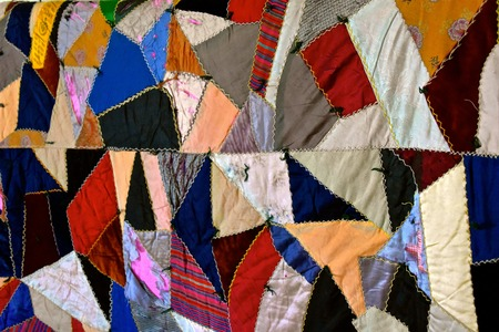 Aaa very old crazy quilt with patches of many colors