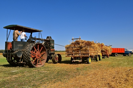 PEKIN, NORTH DAKOTA, September 2, 2018: An antique Oil Pull Rumely steam engine is belted for threshing during the Labor Day Stump Lake Village Thresher Bee.