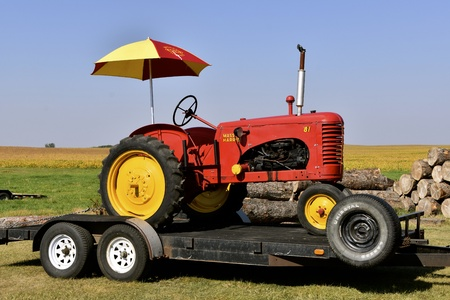 PEKIN, NORTH DAKOTA, September 2, 2018: a Massey Harris 81 antique tractor on a trailer will be publicly displayed  during the Labor Day Stump Lake Village Threshing Bee.