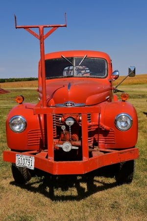 PEKIN, NORTH DAKOTA, September 2, 2018: An old restored classic red International pickup with a closeup view of the front hood and grill is on display during the Labor Day Stump Lake Village Threshing Bee.