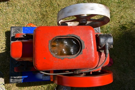 Birdseye view of a restored old antique gas engine painted red and blue Stock Photo