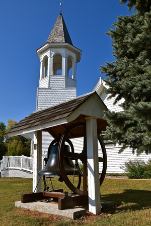 An old bell has been removed from the belfry on a church and is displayed at ground level. 写真素材